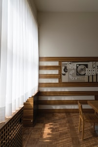 white laced curtain inside room