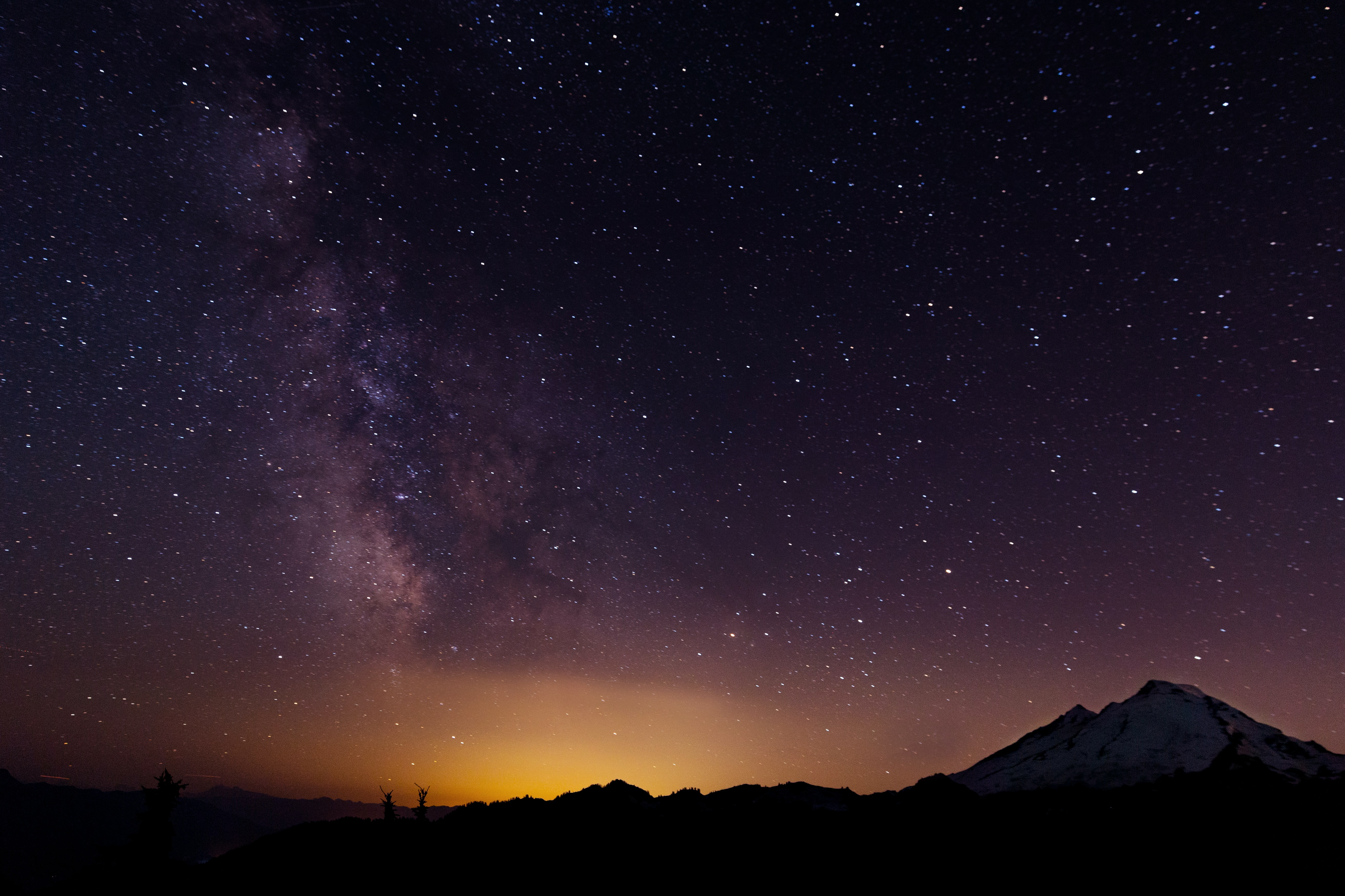 silhouette of mountains during nighttime