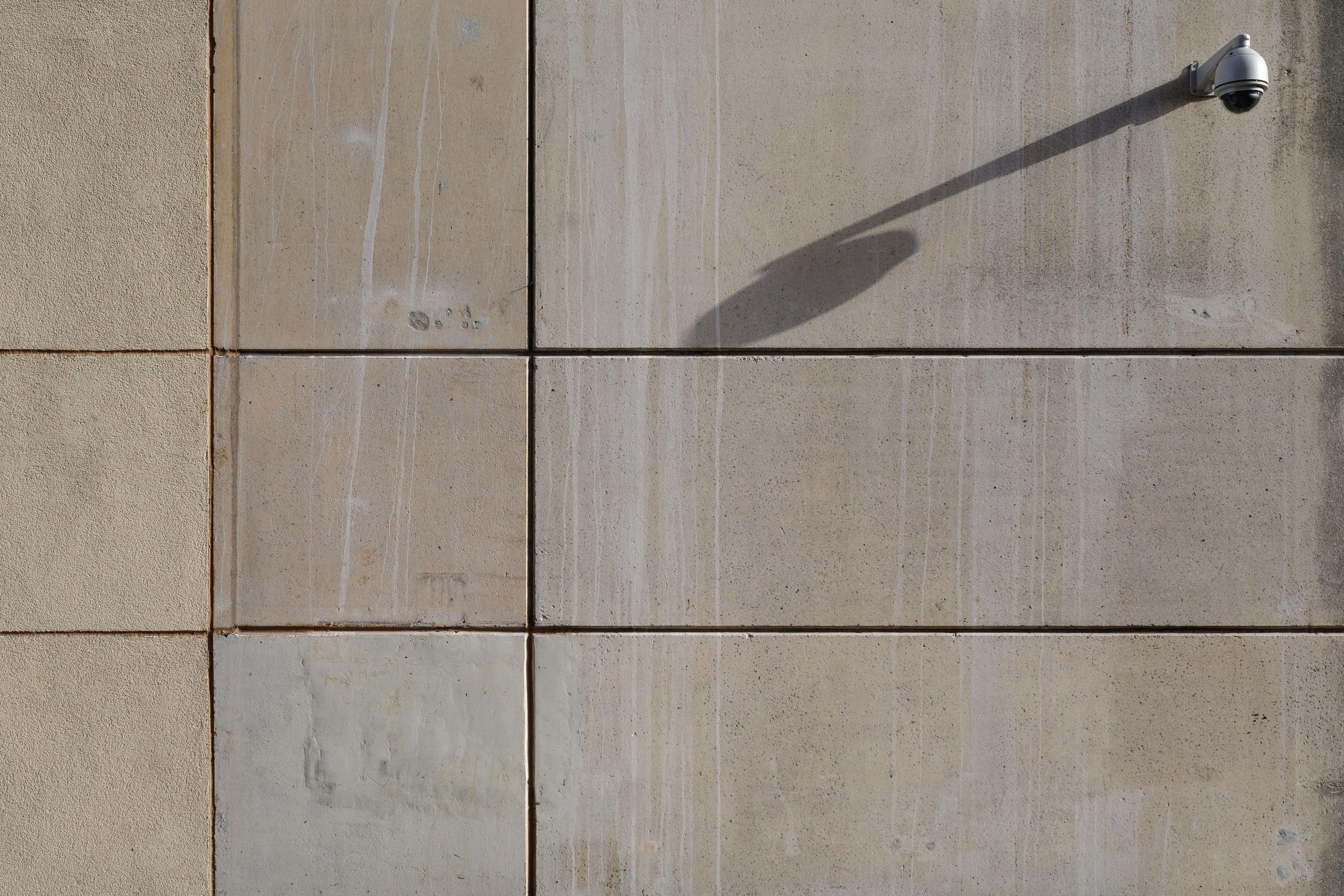 photo of white wall-mounted light