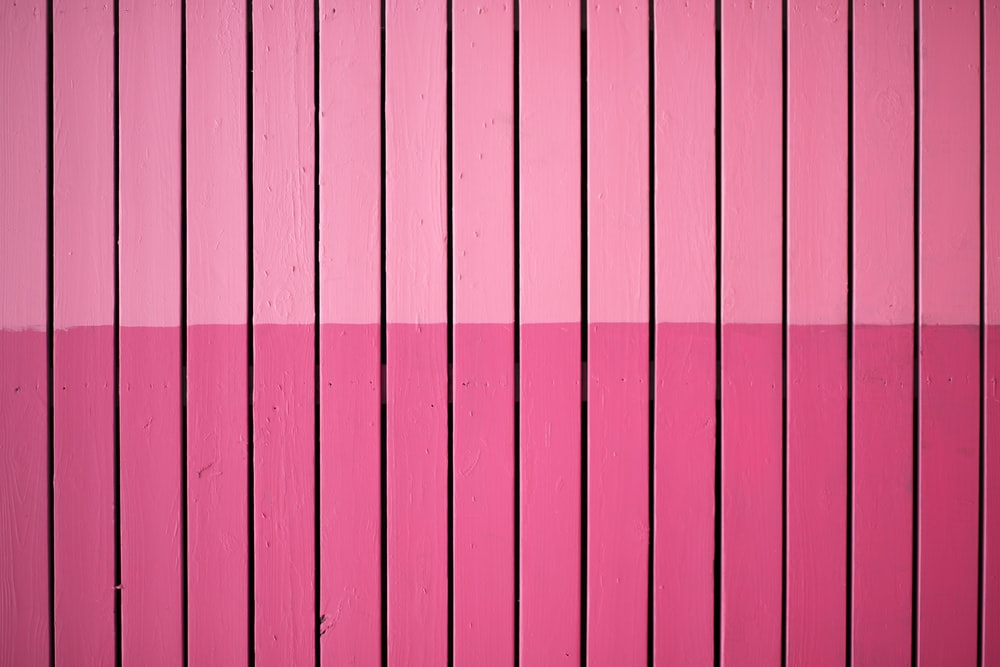 closeup photo of pink paint plank wall
