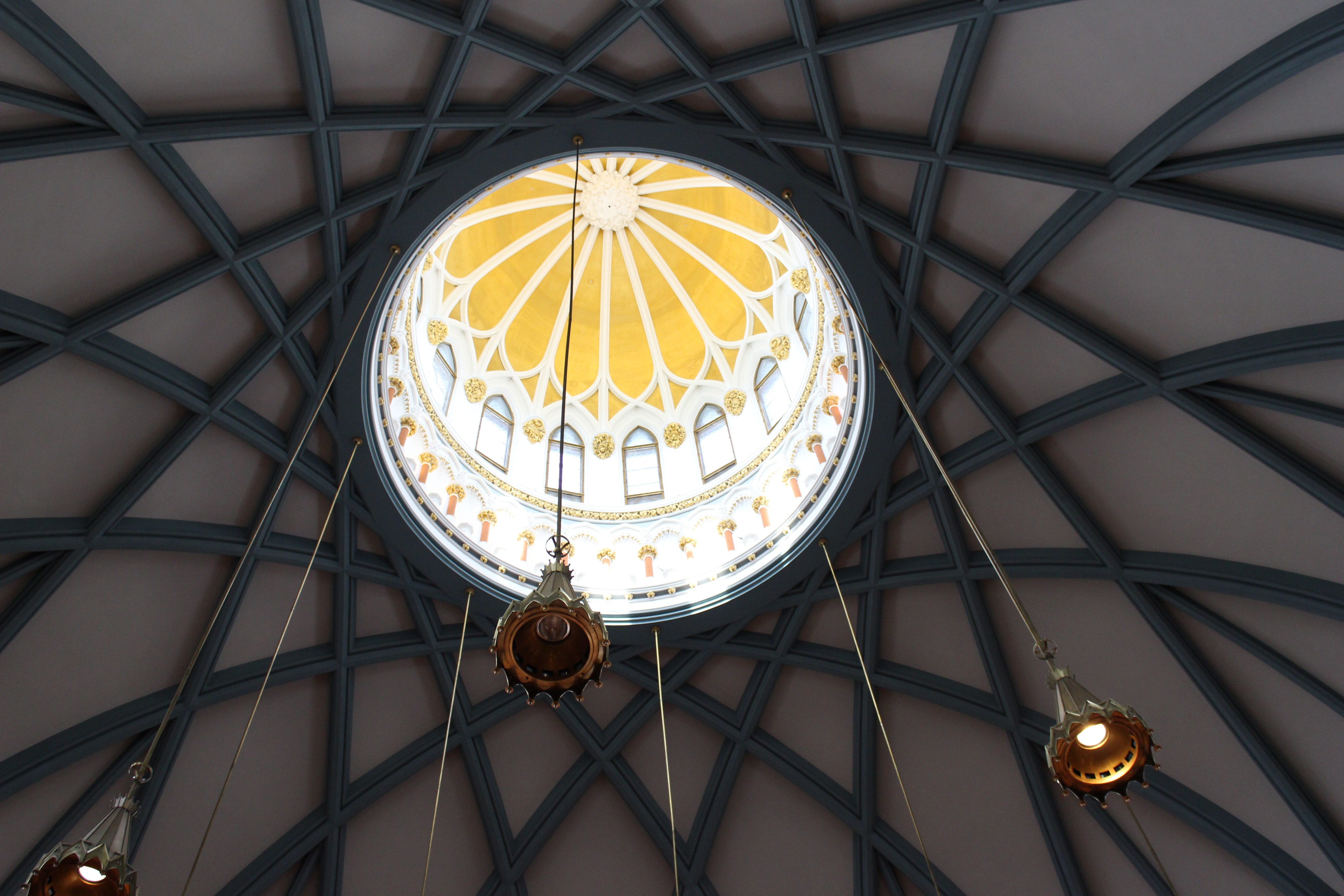 photo of hanging pendant lamps on building ceiling