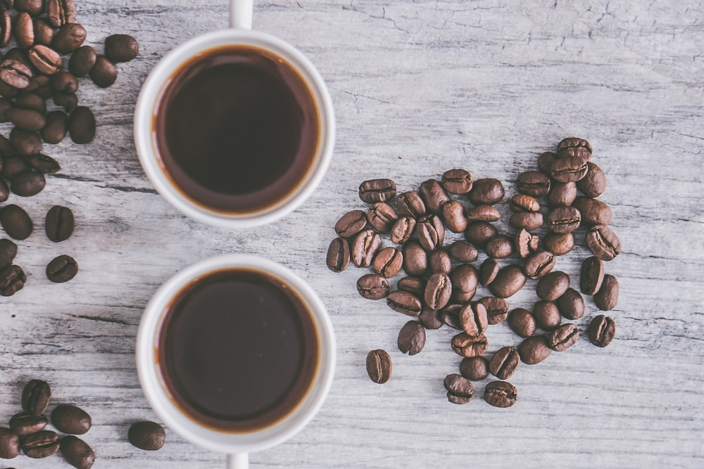 flat lay photo of cup black coffee