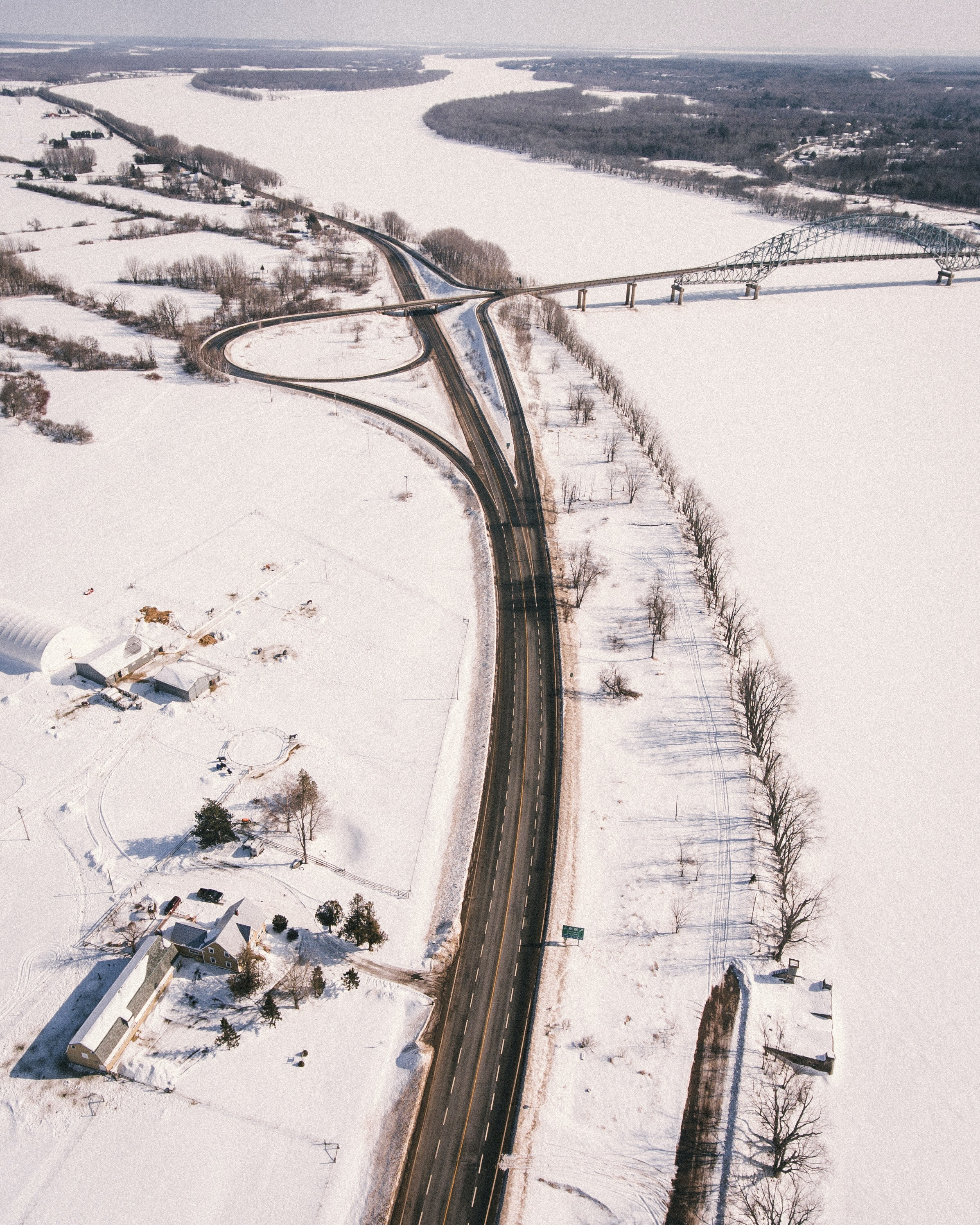 aerial view of road surrounded by white snows