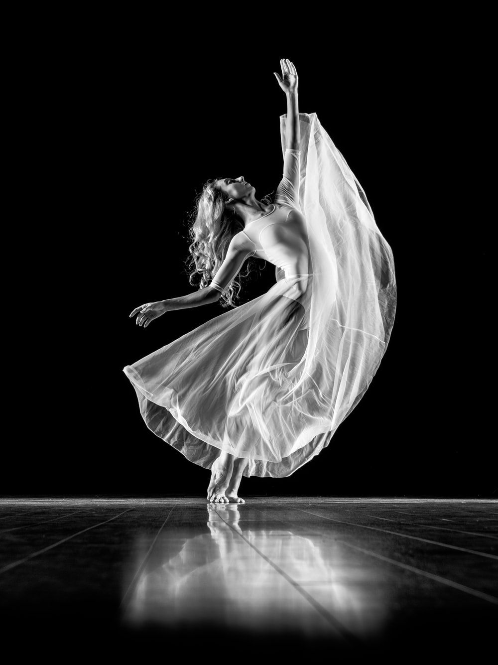 grayscale photography of woman doing ballet