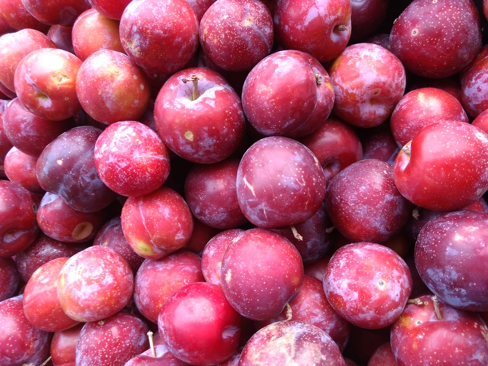 bunch of round red fruits