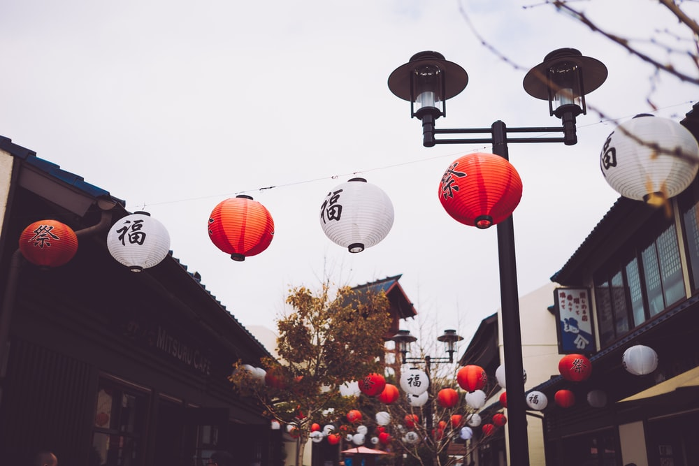 black street light beside lanterns