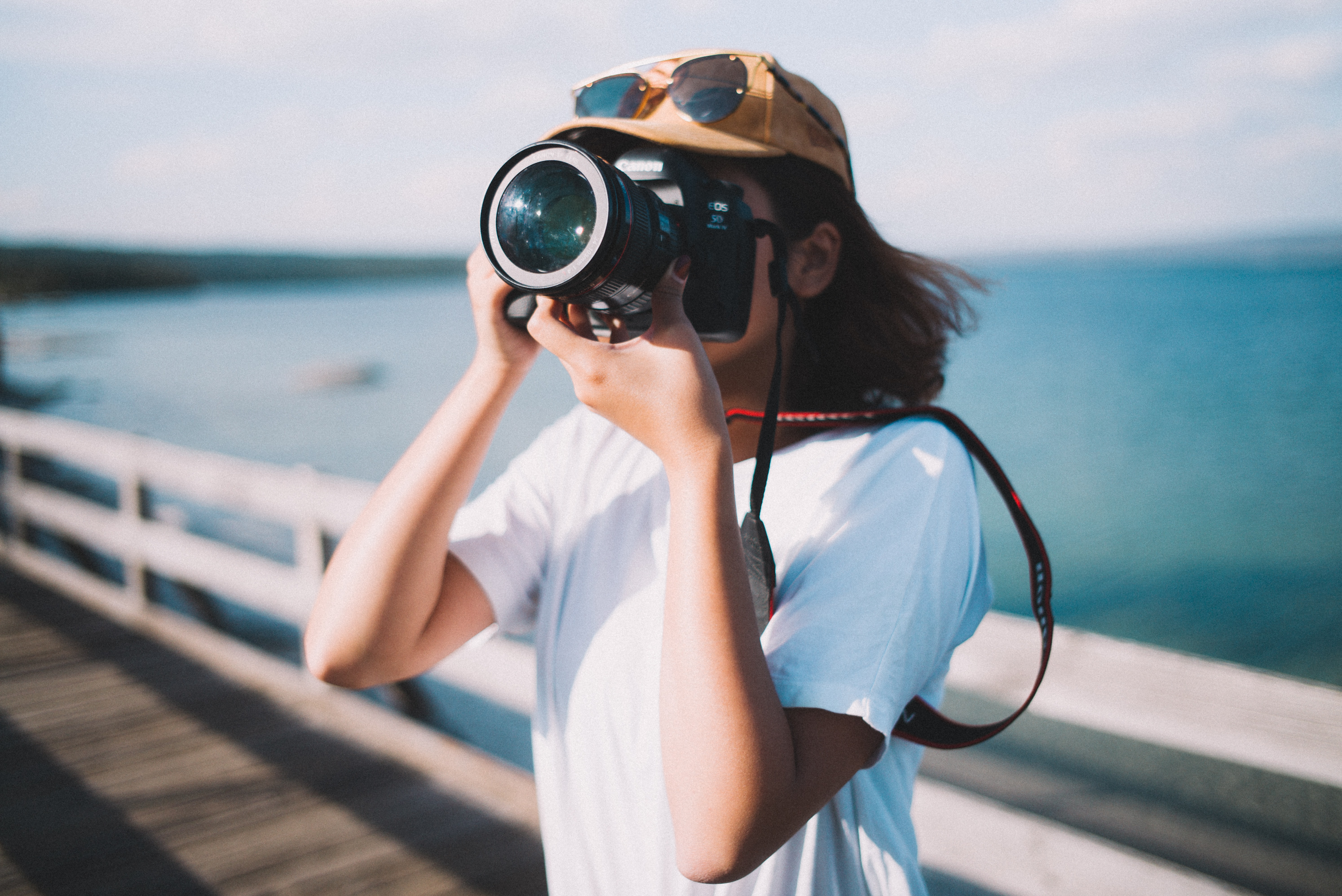 woman taking picture of her view