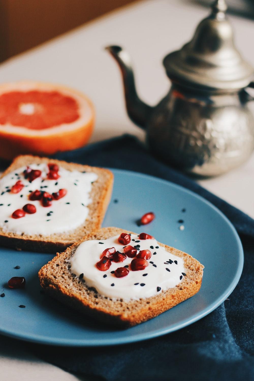 flatlay photography of spreaded bread beside teapot