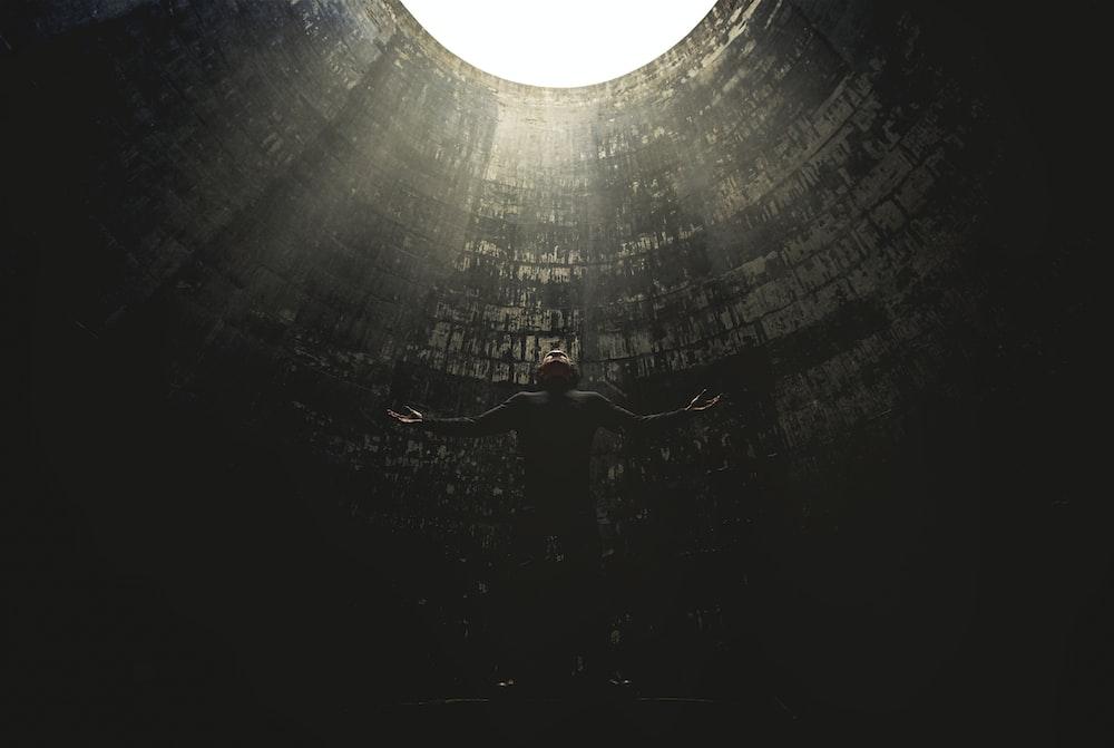 man standing under hole