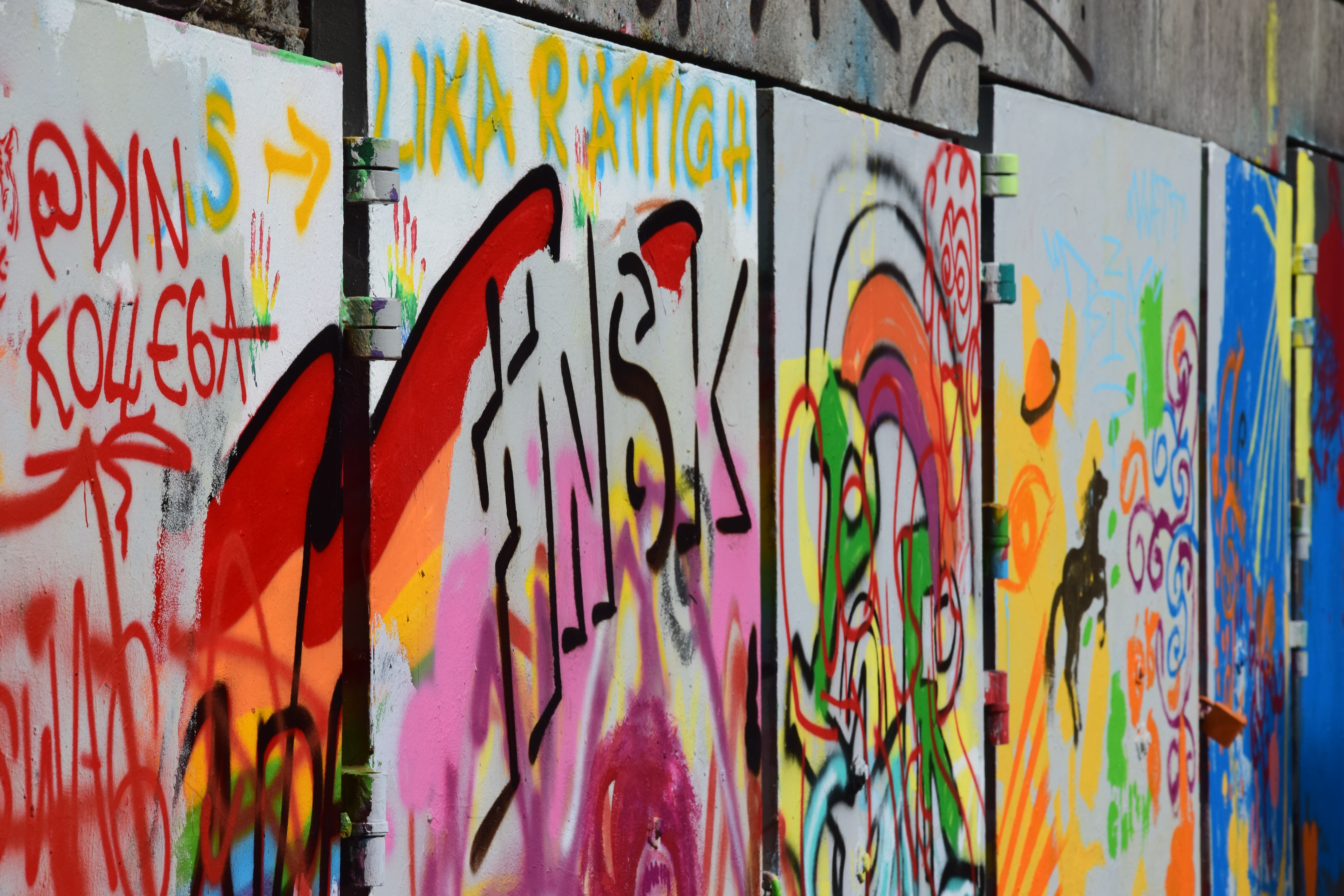 multicolored graffiti on gray doors
