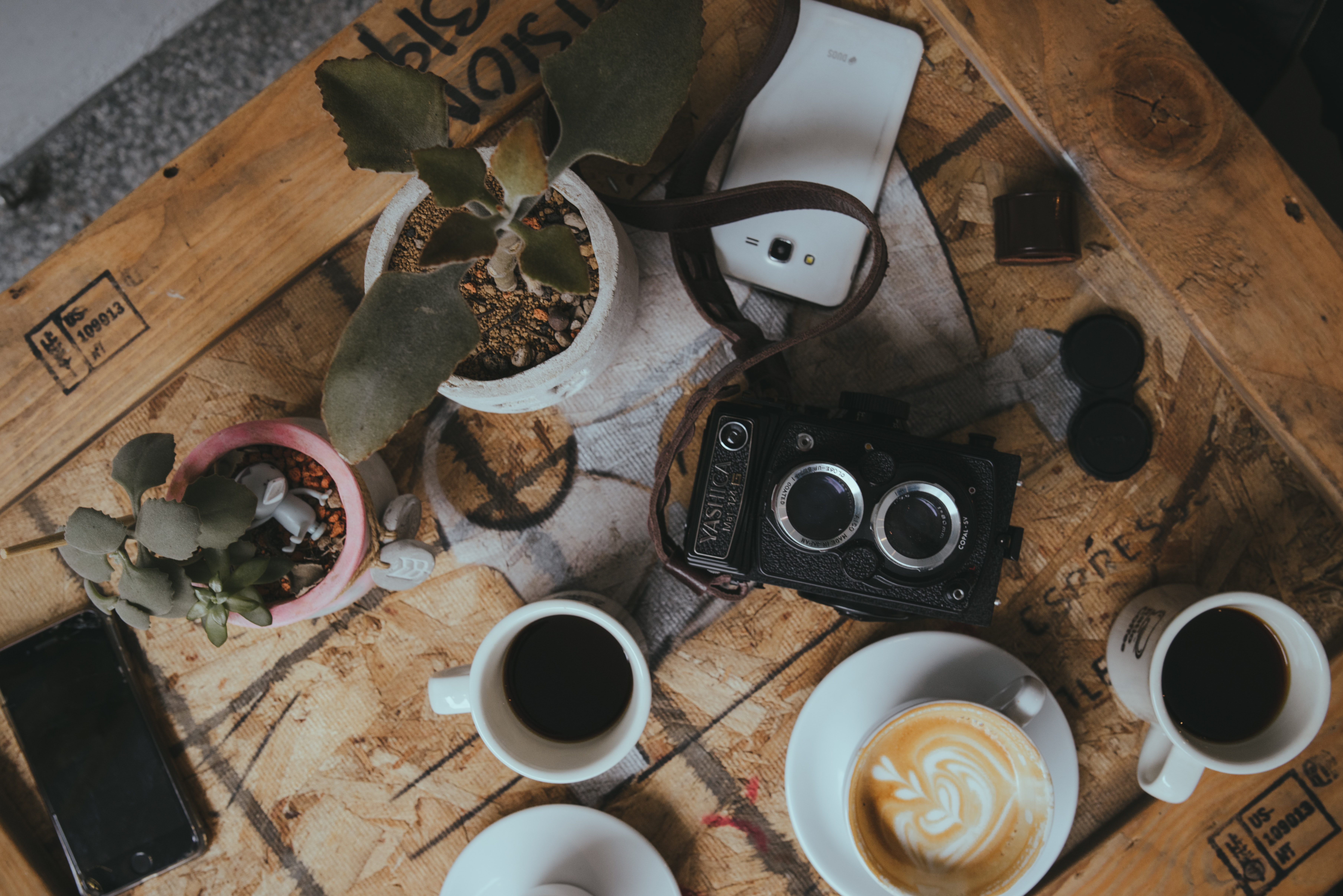 flat lay photo of coffee and camera