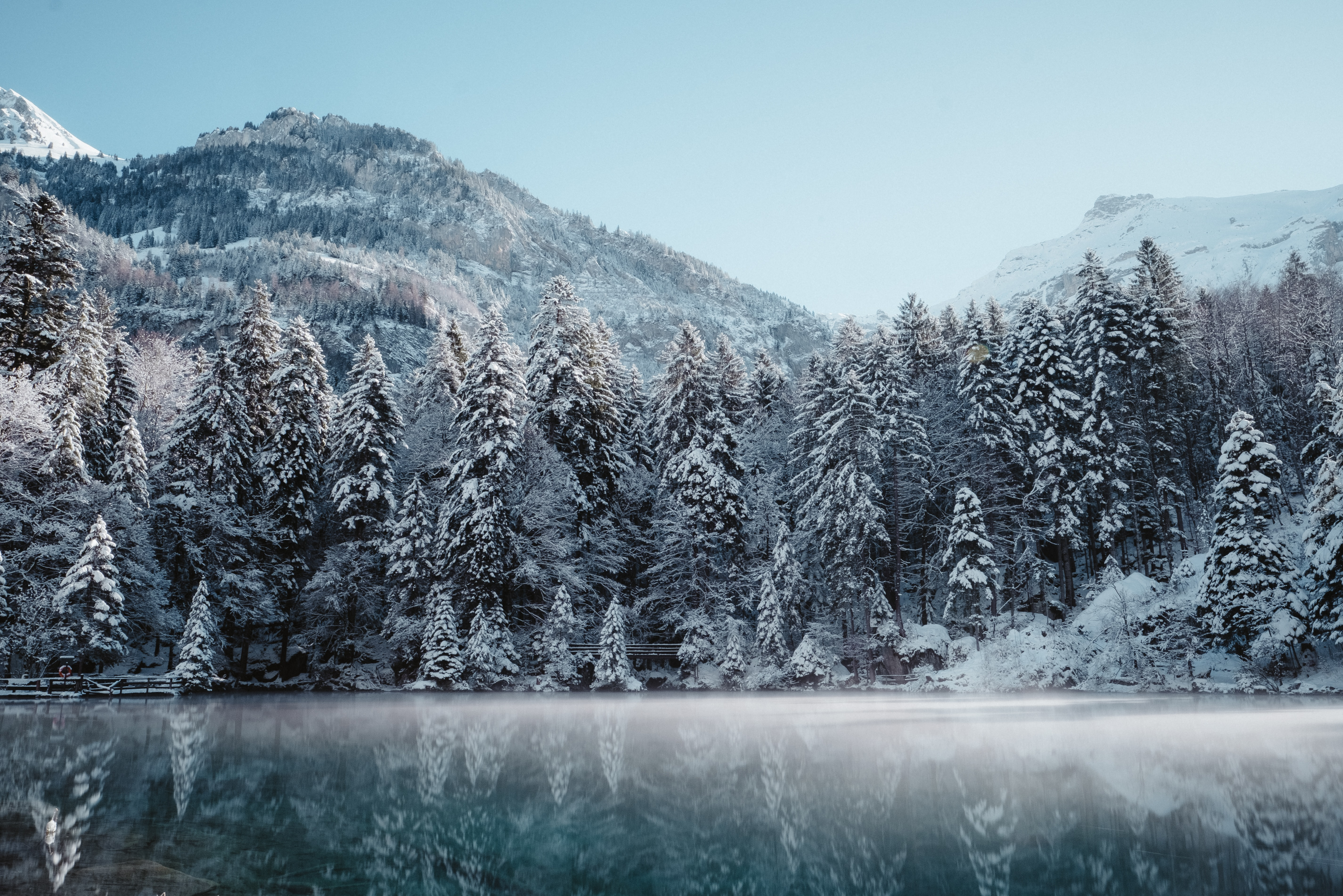 landscape photography of snowy mountain and body of water