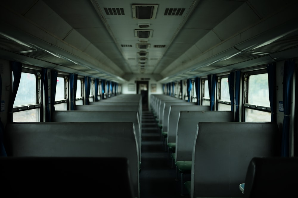 inside view of white bus displaying seats