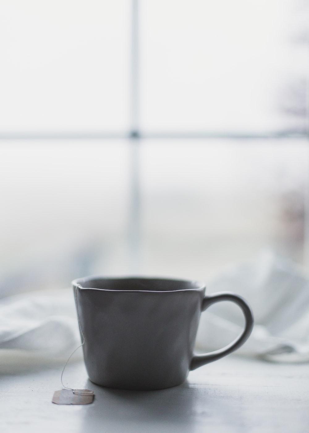 white ceramic teacup