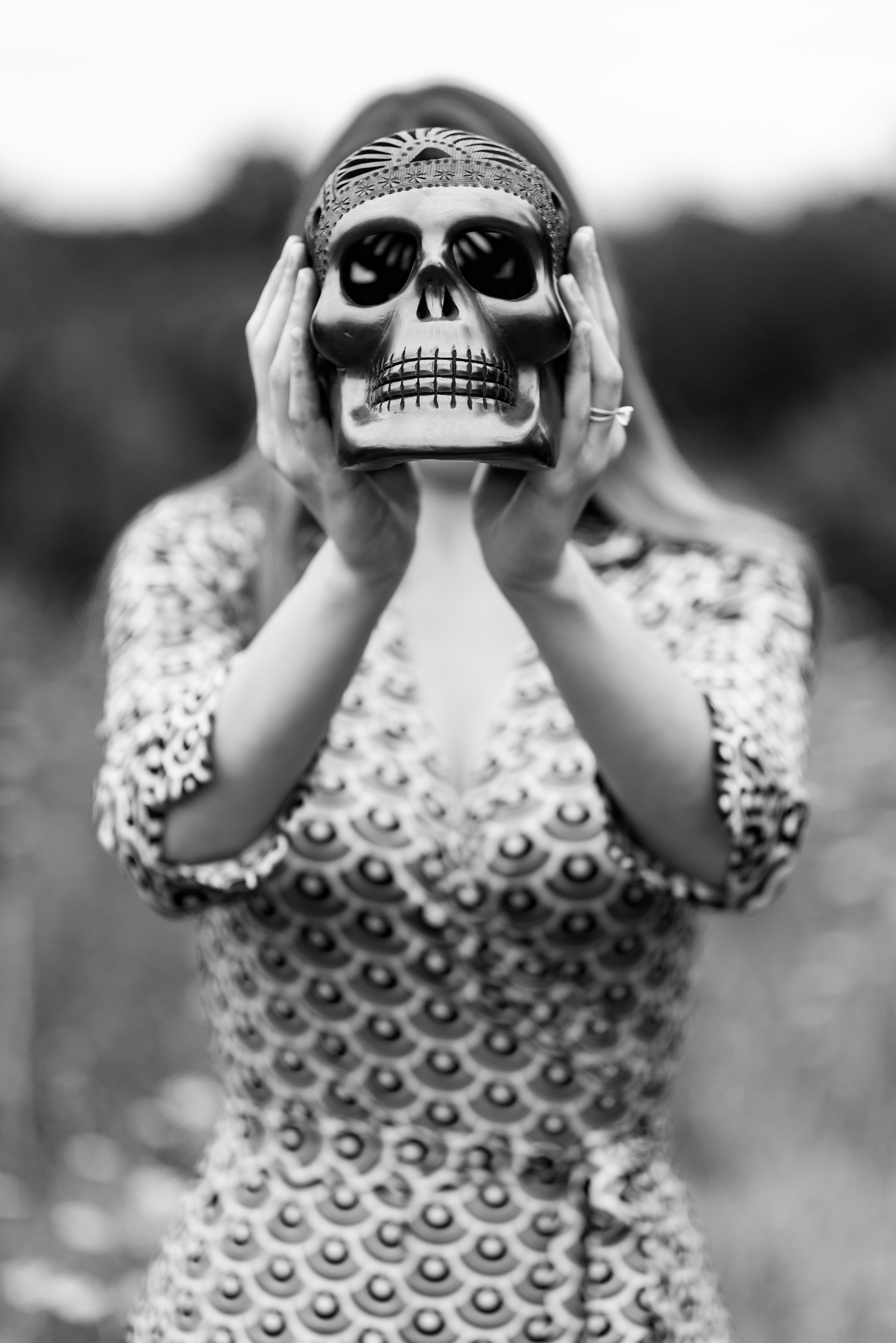 grayscale photography of woman holding skull figurine