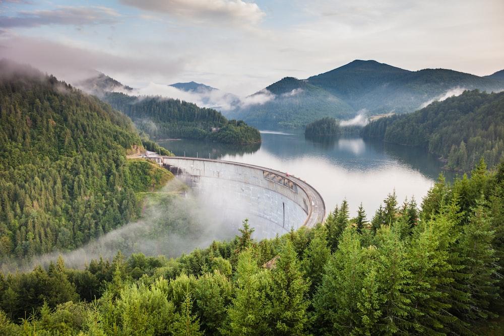 white bridge between mountains