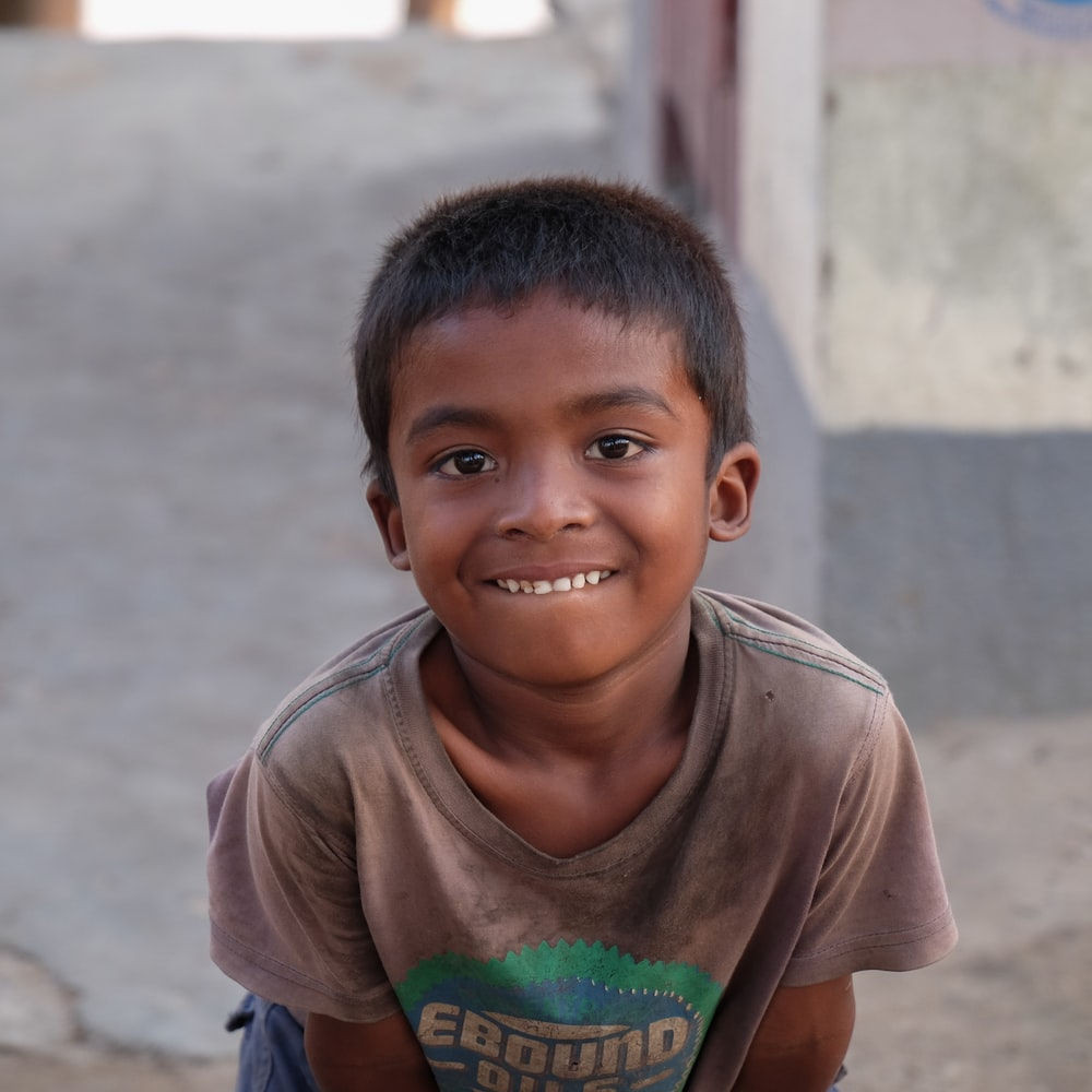 selective focus photography of boy showing his teeth