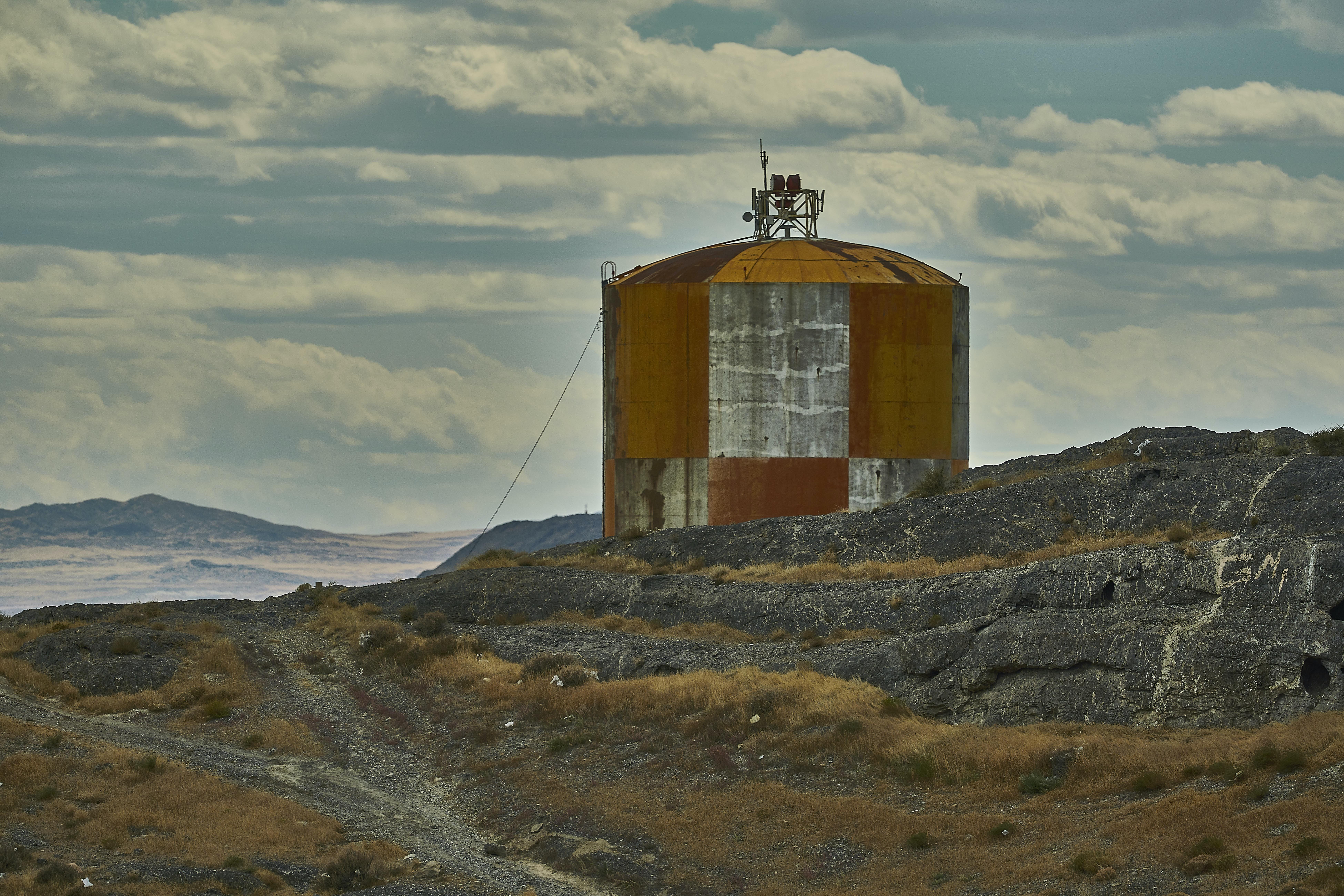 brown and gray tank near mountain