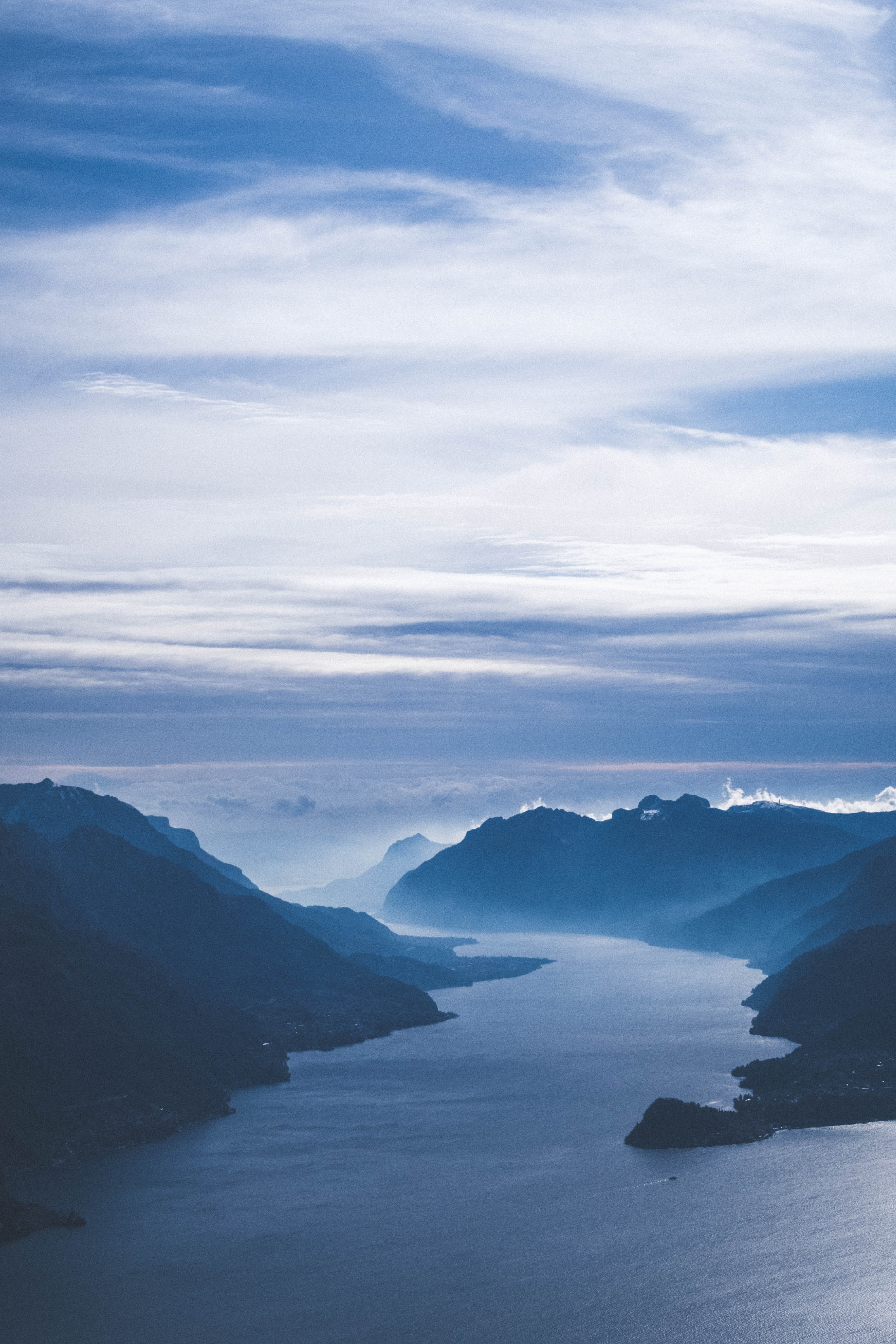 bird's eye view of body of water and mountains