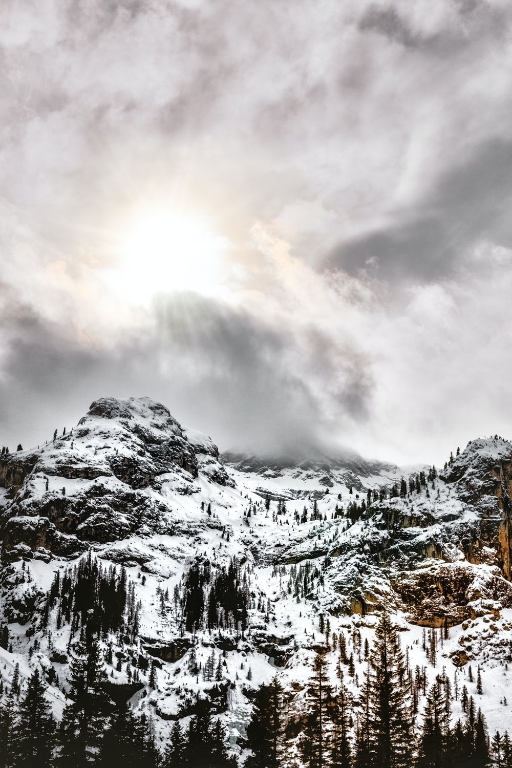 photography of mountain under sky