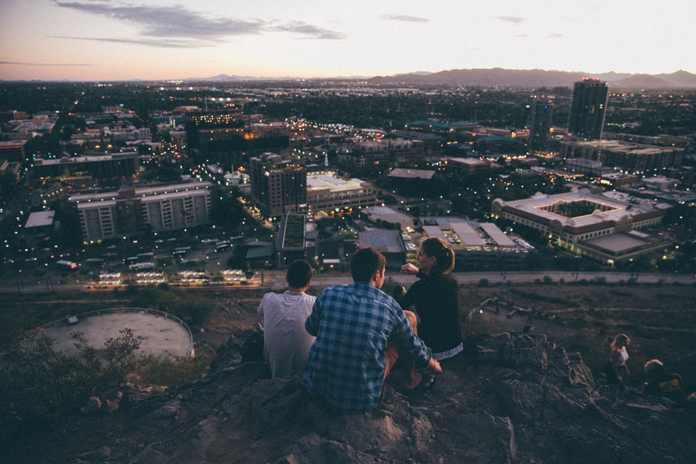 three person on cliff