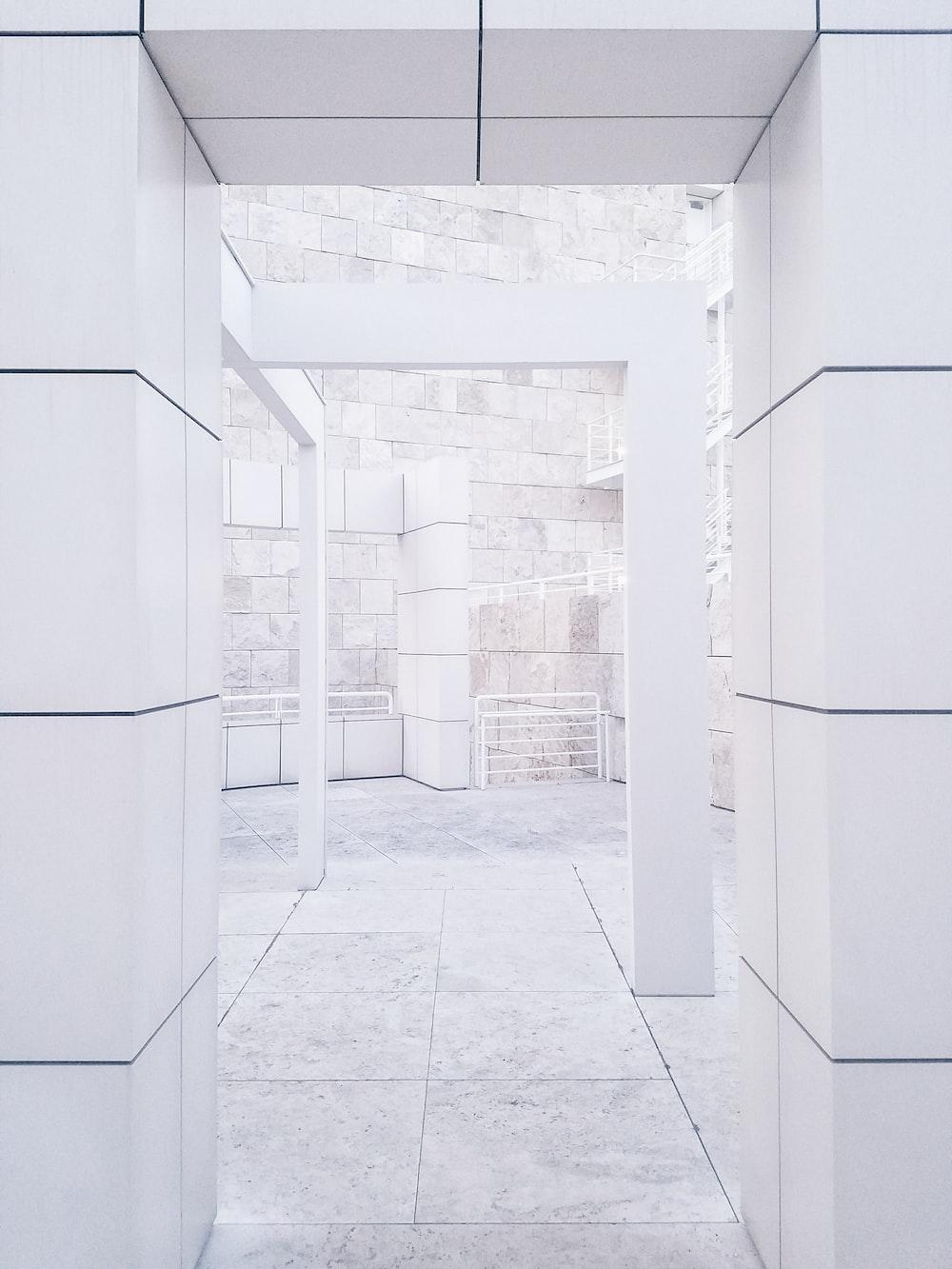 photo of empty arch hallway