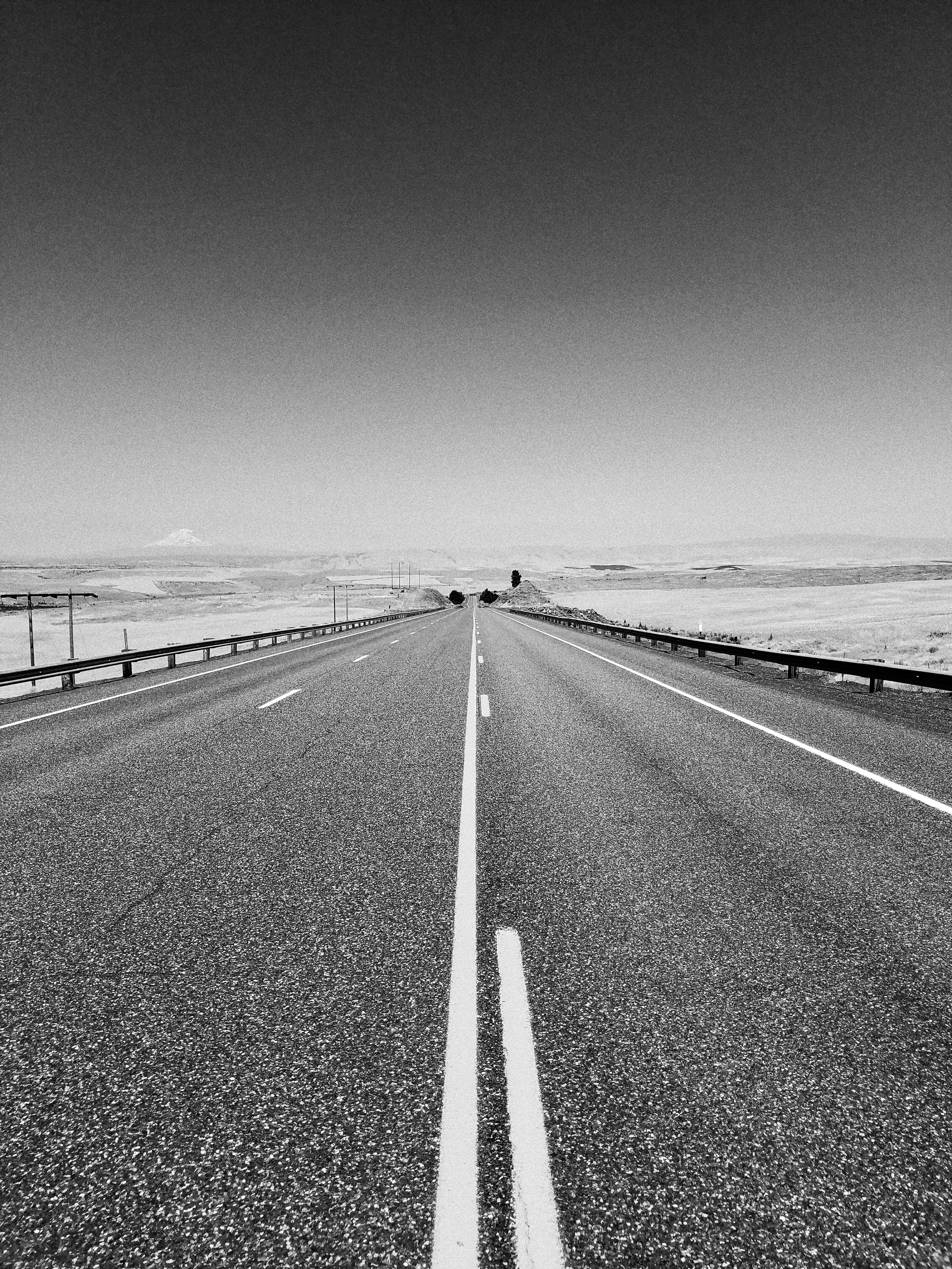 grayscale photo of concrete road