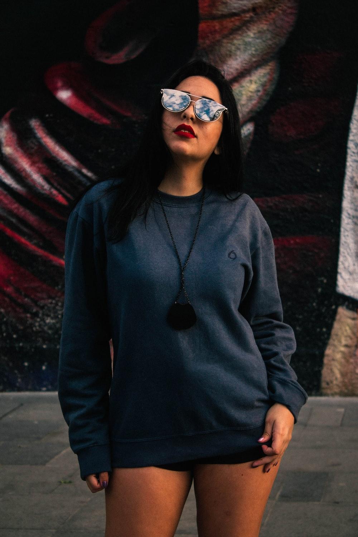 woman standing near graffiti wall during daytime