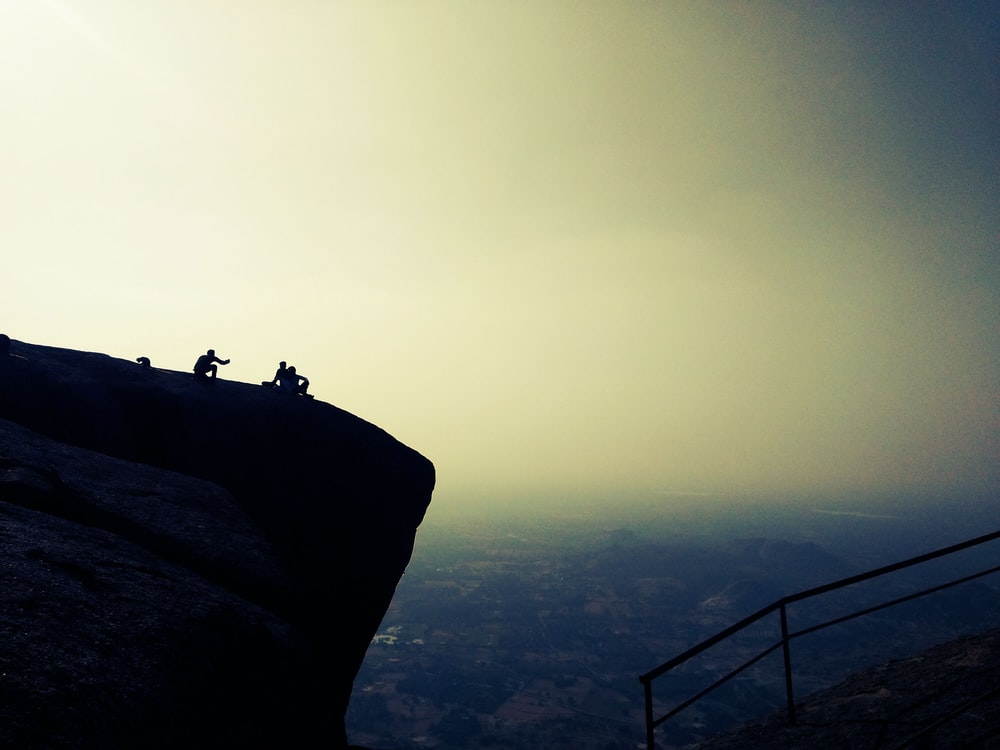 person on top on the mountain