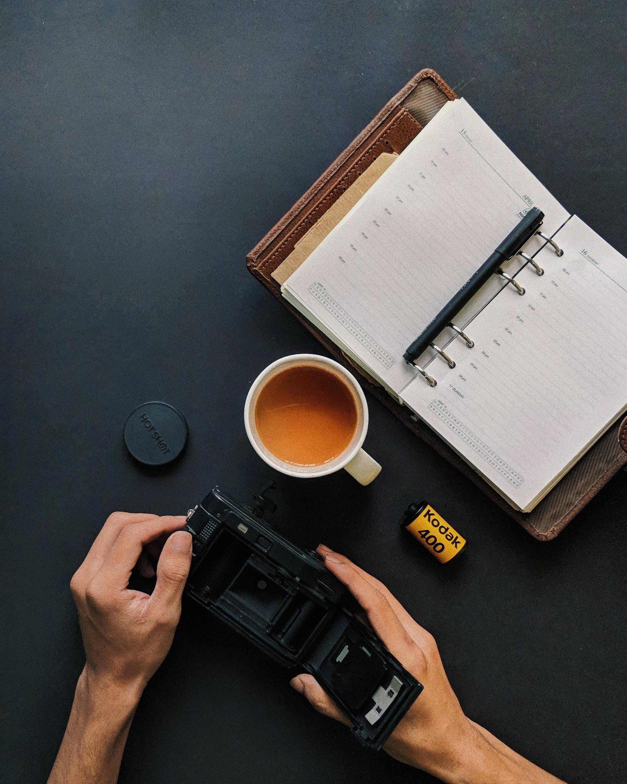 person holding Kodak camera