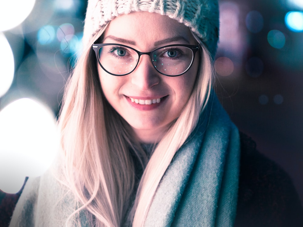 bokeh photo of woman wearing black framed eyeglasses
