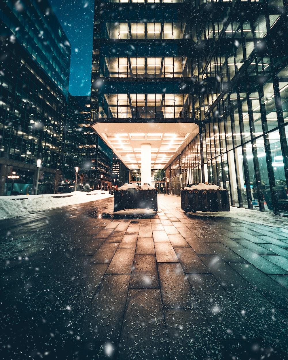 snow street during night time