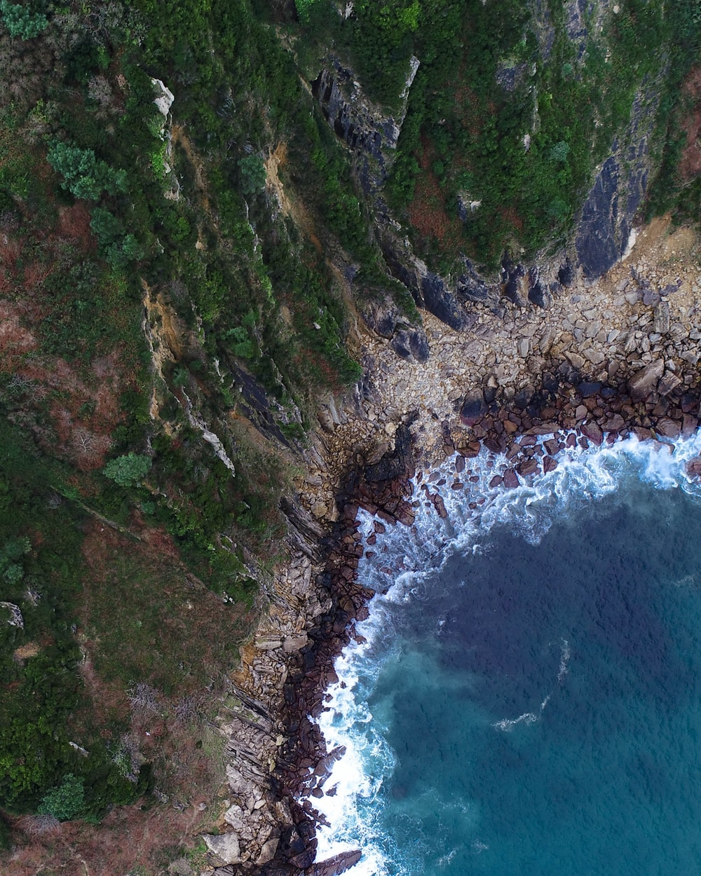 bird's-eye view photography of ocean near island