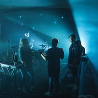 group of band members having discussion on stage