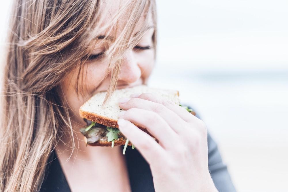 How You Kick-Start a Weight Loss Program woman eating sandwich