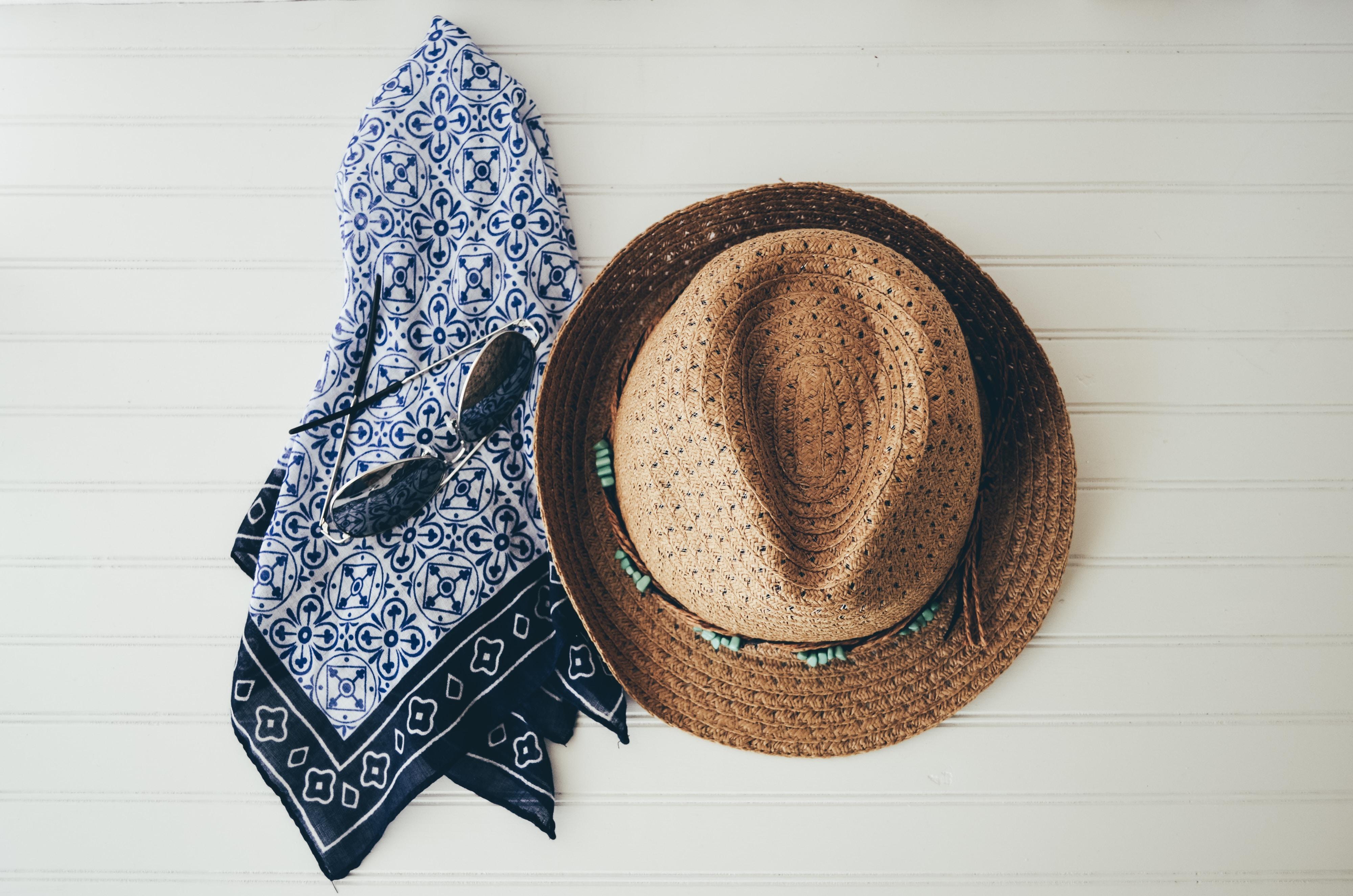 brown hat beside black handkerchief