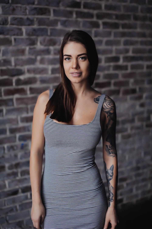 woman wearing black and white striped sleeveless dress