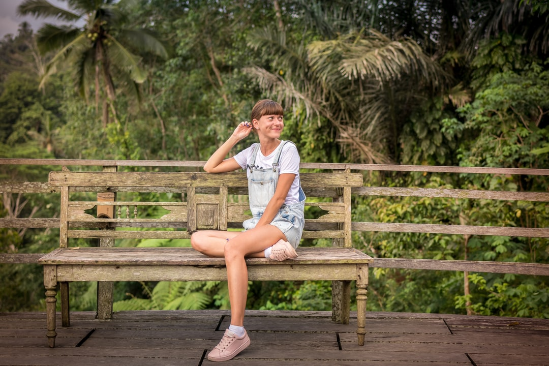 Woman on the bench in the jungle. Bali island, Indonesia.