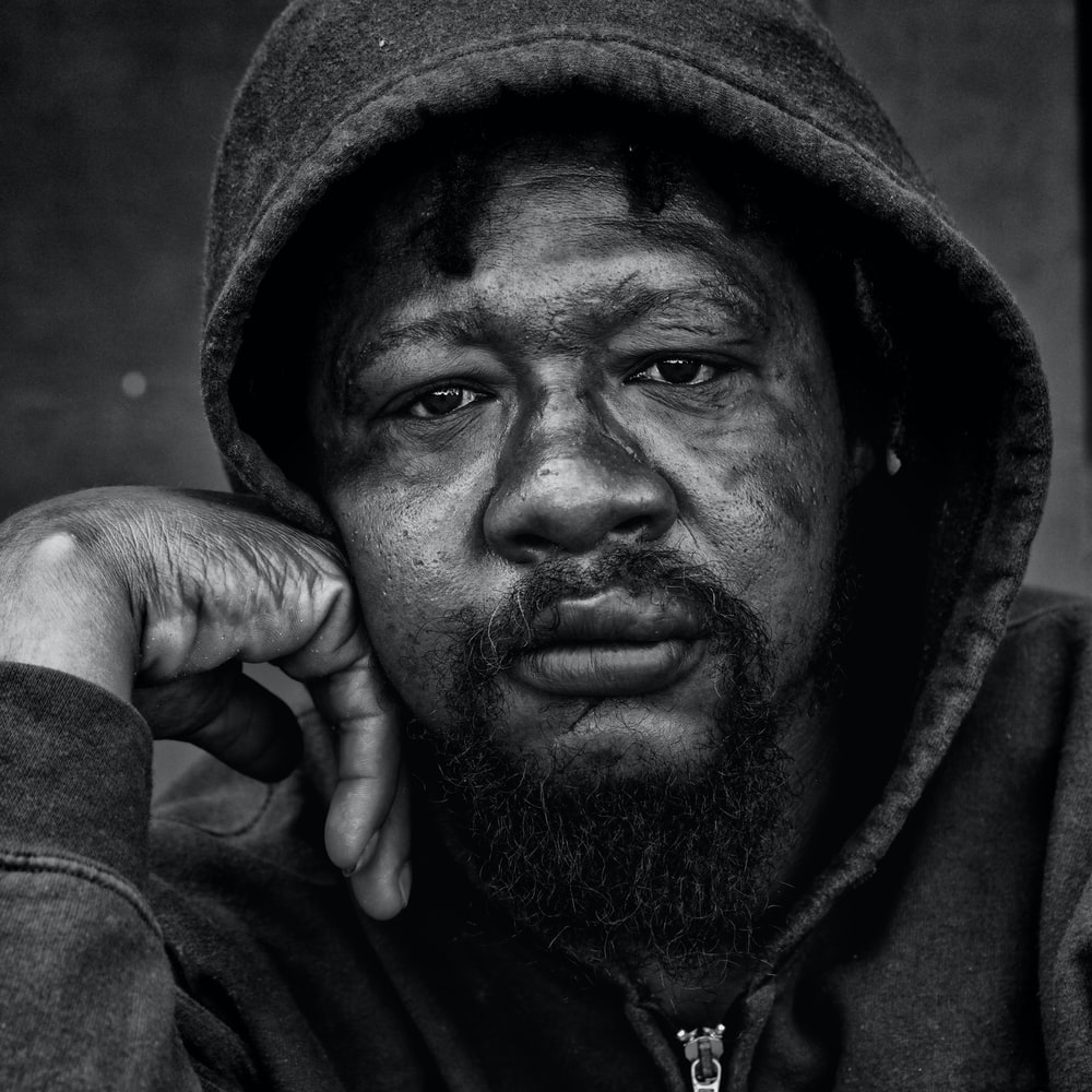 grayscale photo of a man wearing hoodie