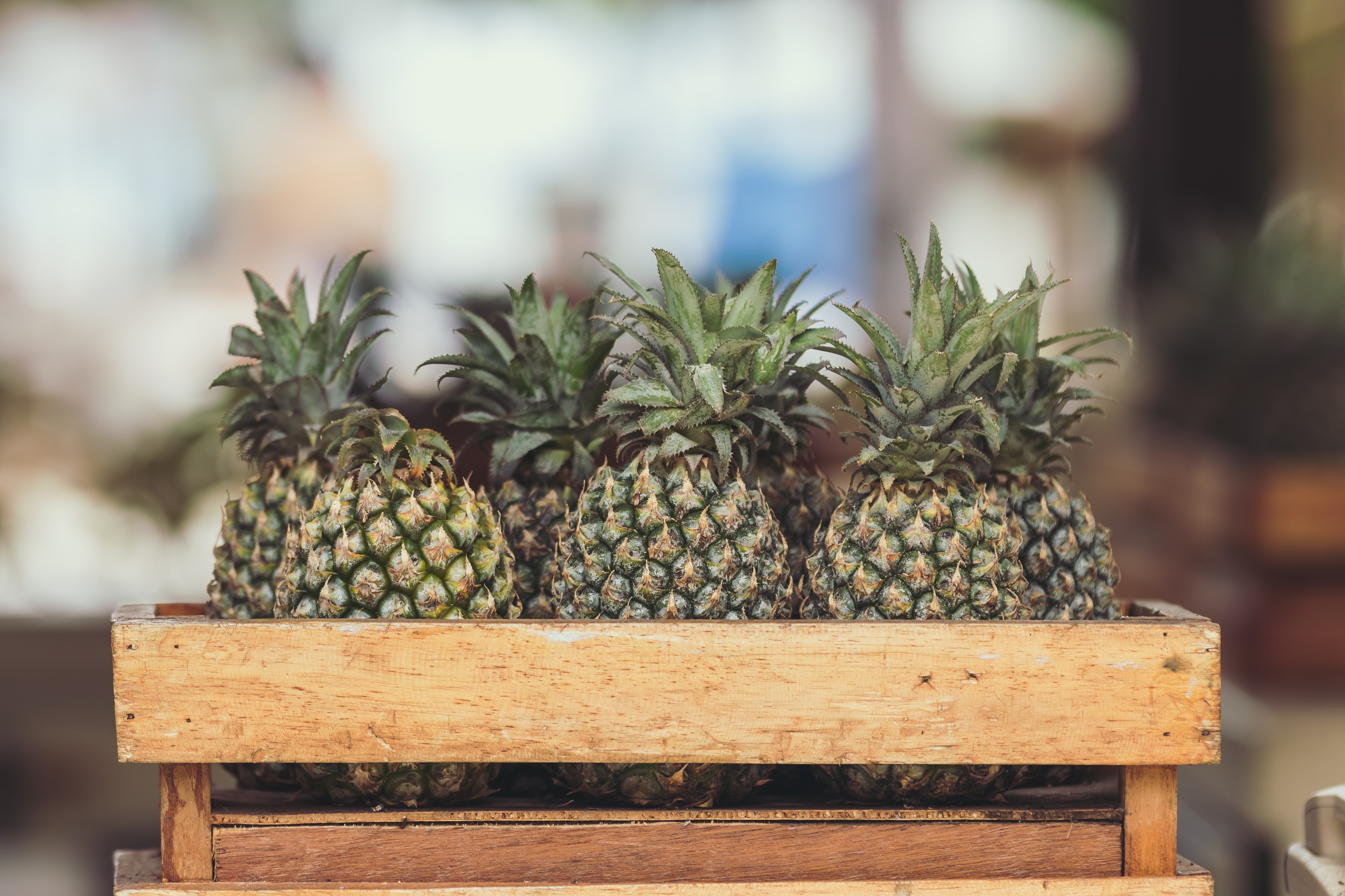crate of pineapples