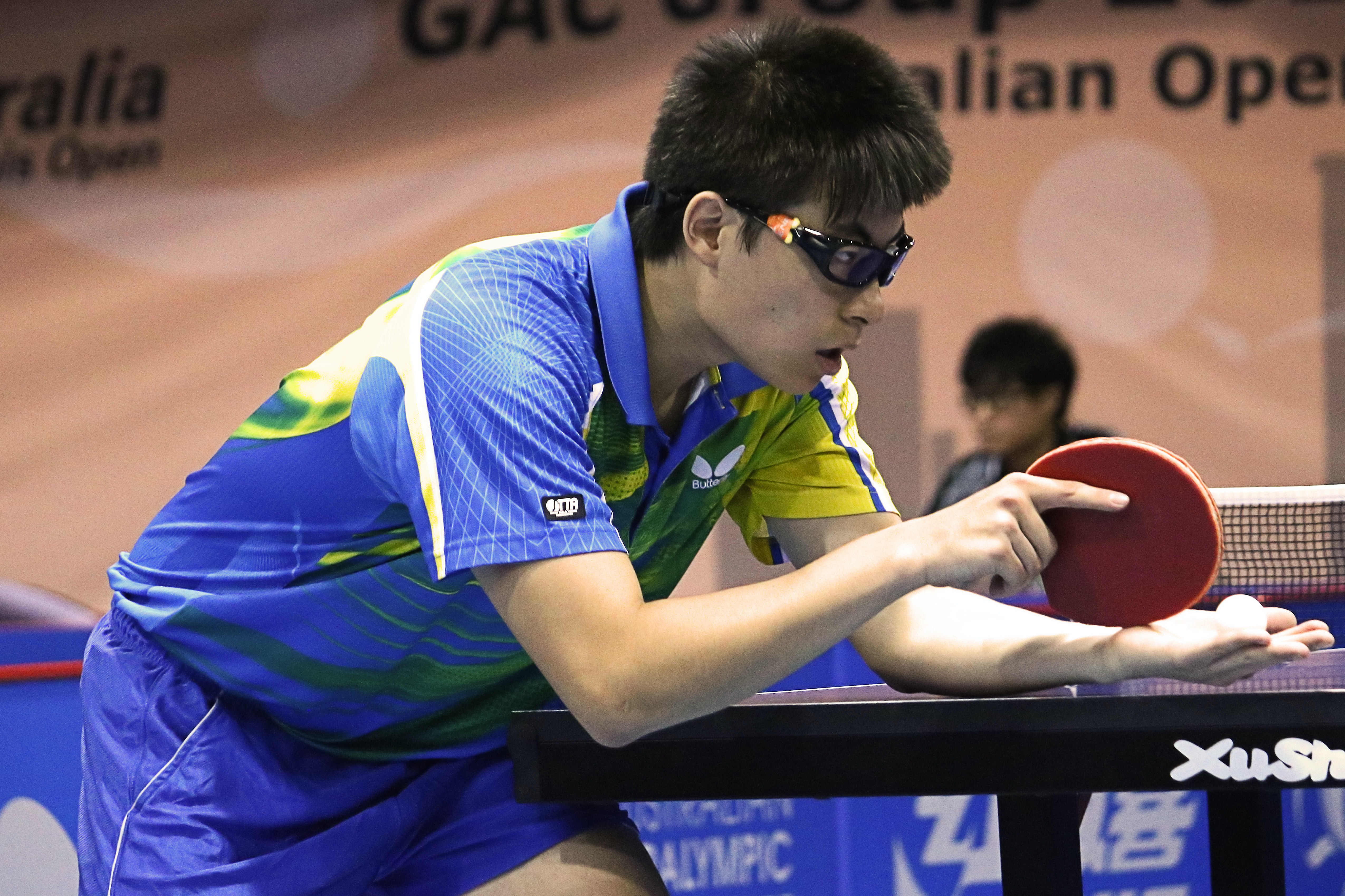table tennis player serving front of table