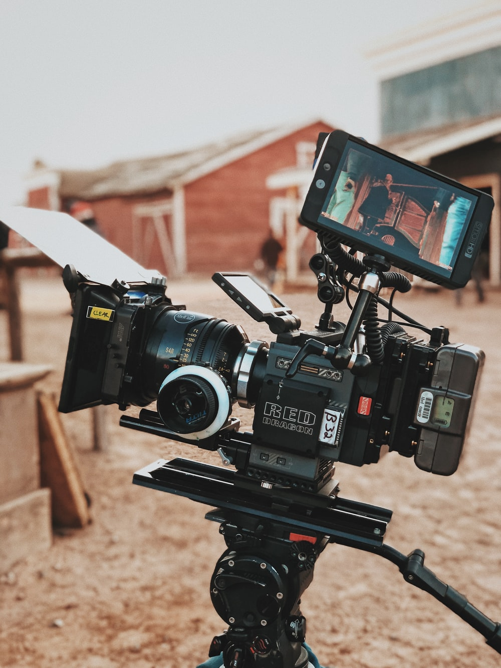 camera filming a brown structure