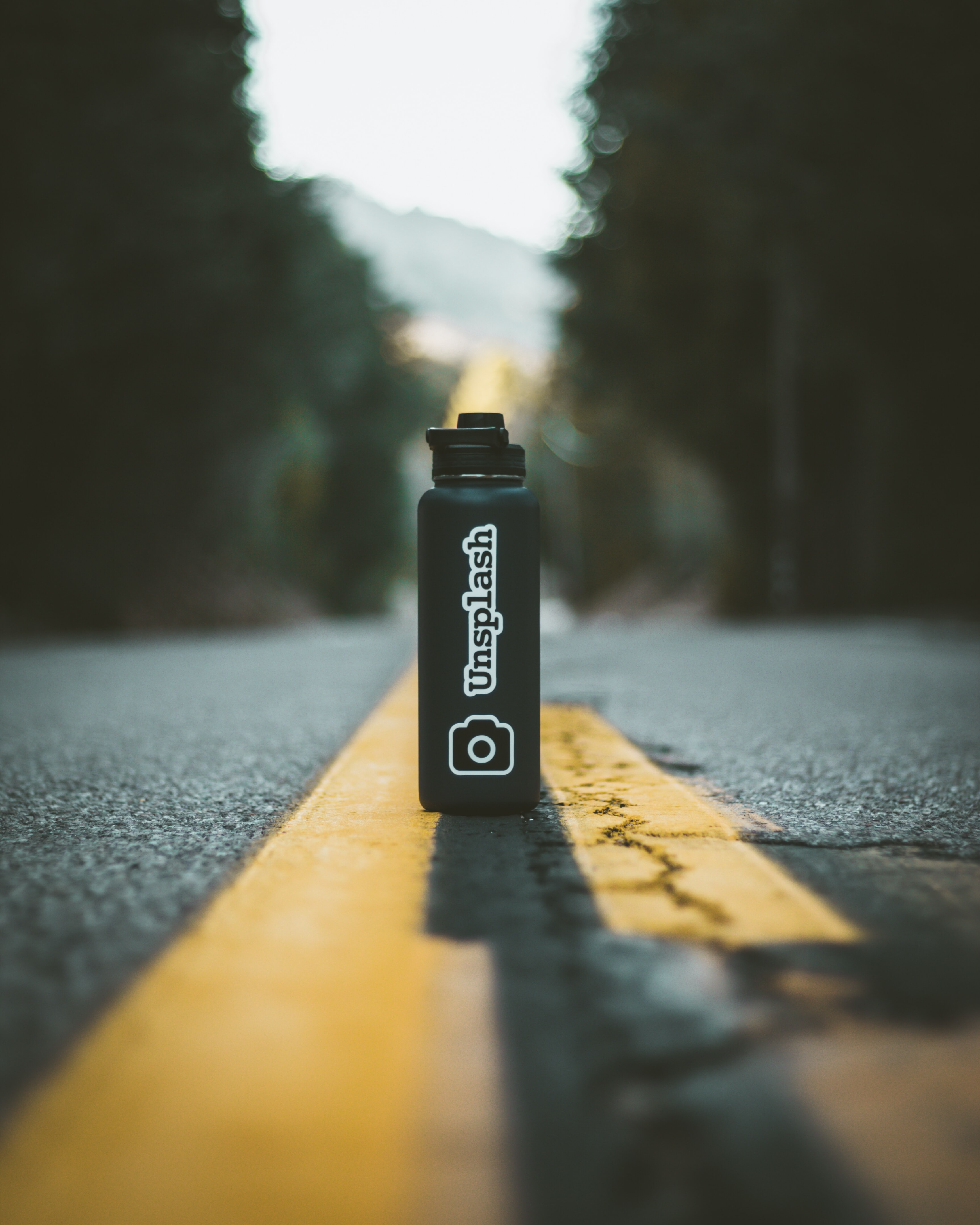 tilt-shift photography of Unsplash bottle
