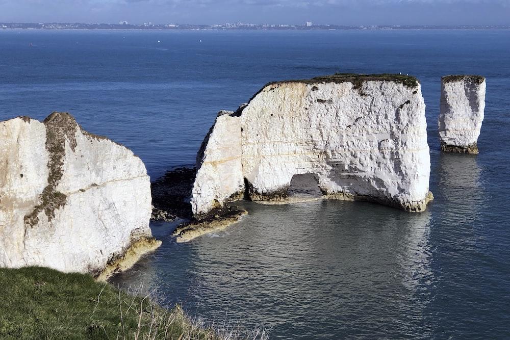 coastal rocks on body of water during daytime