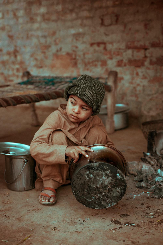 boy holding stock pot