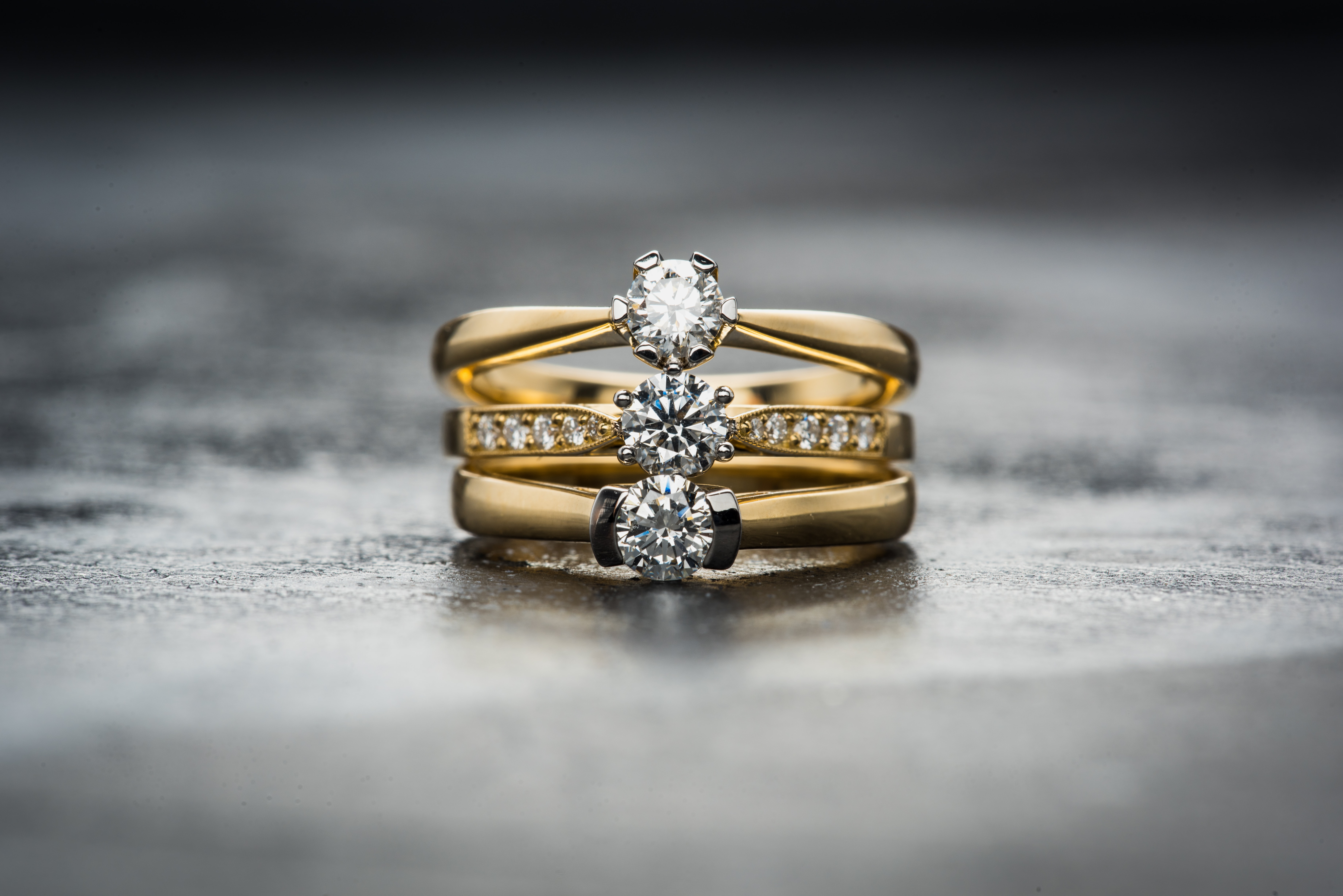 gold-colored clear gemstone trio ring