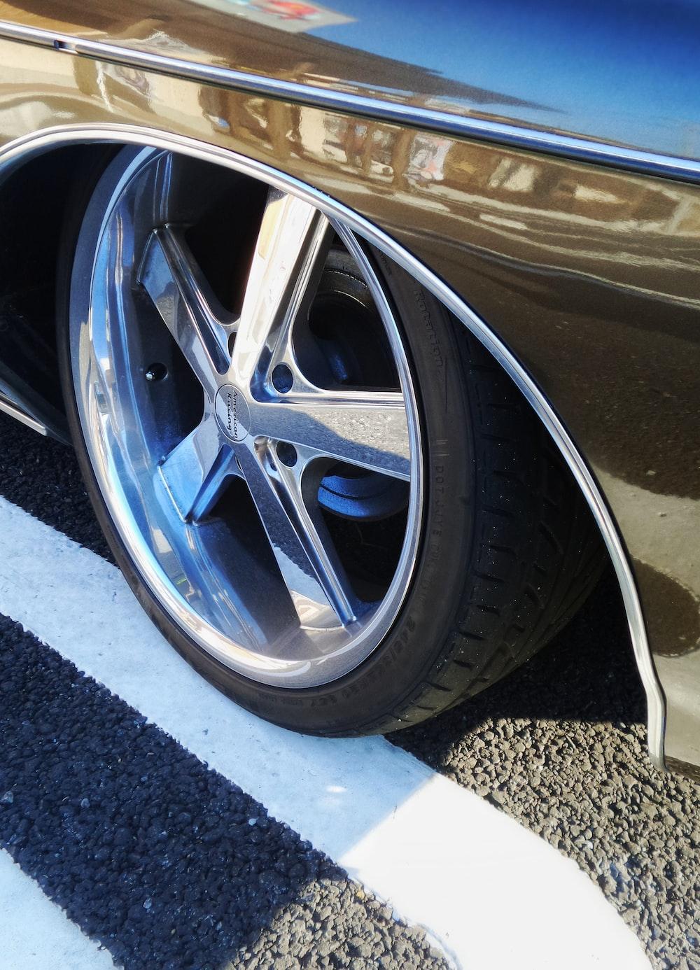 chrome vehicle wheel with black tire