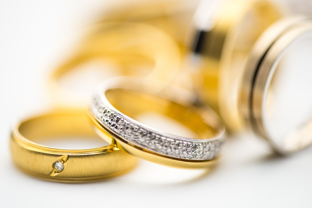 gold-and-silver-colored rings