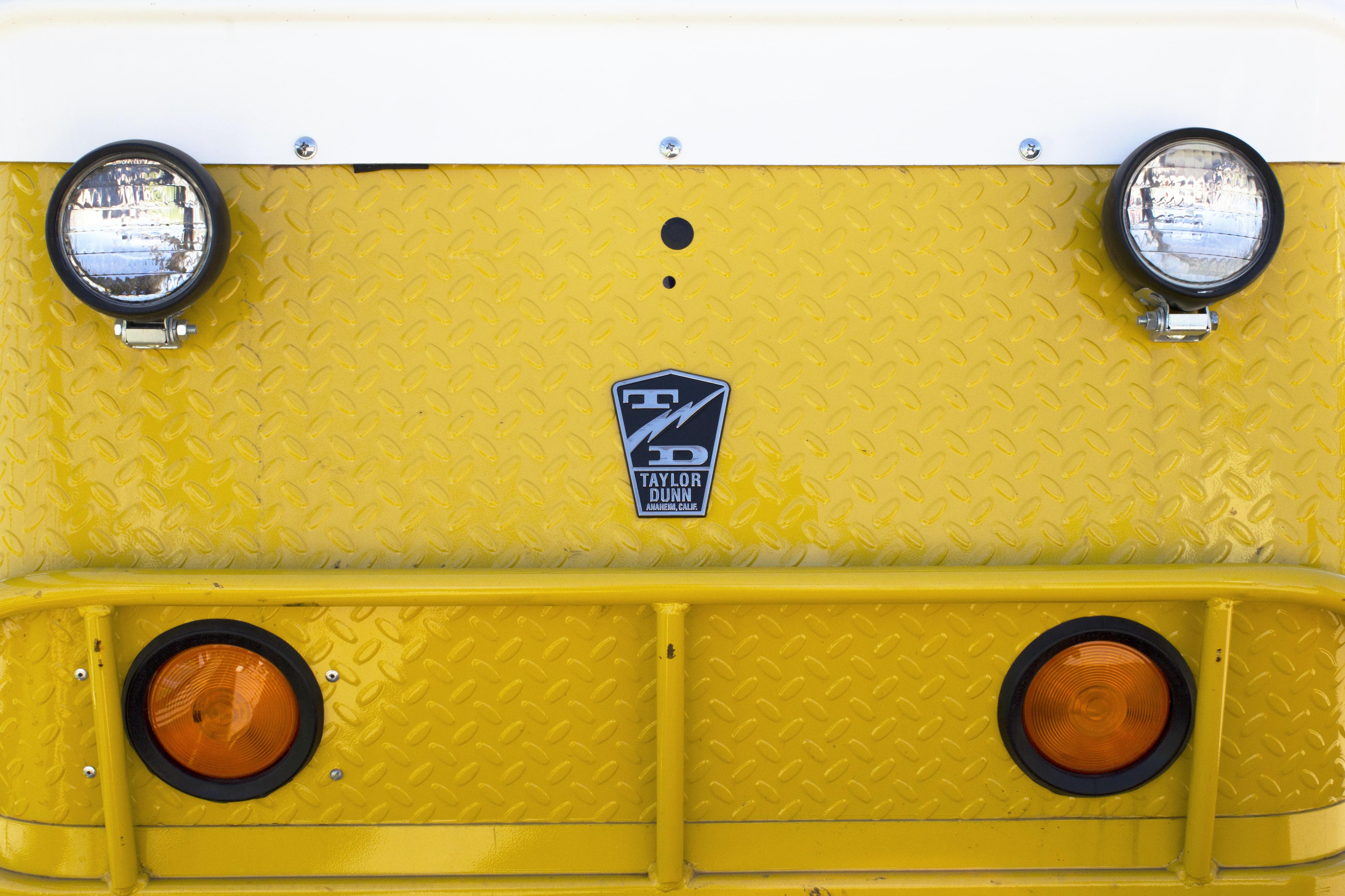 closeup photo of yellow vehicle