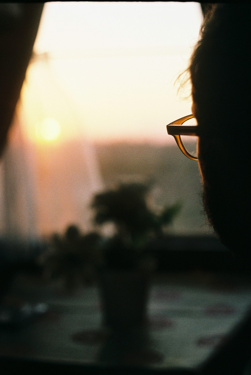 selective focus photography of man's eyeglasses